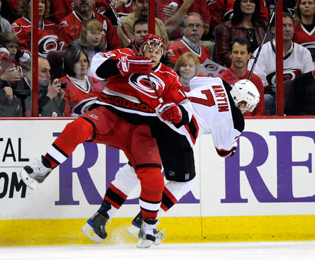 RALEIGH, NC - APRIL 21:  Sergei Samsonov #14 of the Carolina Hurricanes checks Paul Martin #7 of the New Jersey Devils in the first period during Game Four of the Eastern Conference Quarterfinals of the 2009 Stanley Cup Playoffs on April 21, 2009 at the RBC Center in Raleigh, North Carolina.  (Photo by Grant Halverson/Getty Images)