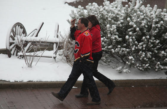 CALGARY, CANADA - APRIL 22:  Fans walk through the snow towards the Pengrowth Saddledome for Game Four of the Western Conference Quarterfinals of the 2009 Stanley Cup Playoffs between the Calgary Flames and the Chicago Blackhawks on April 22, 2009 in Calgary, Alberta, Canada.  (Photo by Mike Ridewood/Getty Images)