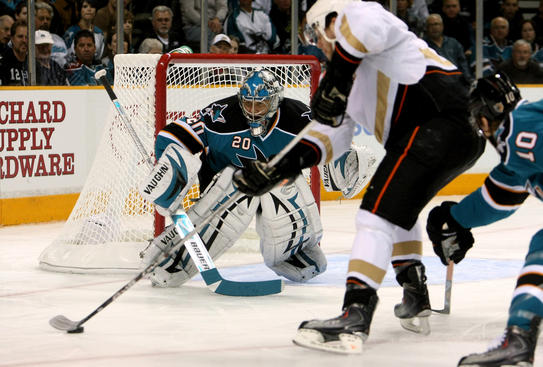 SAN JOSE, CA - APRIL 25:  Goaltender Evgeni Nabokov #20 of the San Jose Sharks eyes a puck on the stick of Bobby Ryan #9 of the Anaheim Ducks  during Game Five of the Western Conference Quarterfinal Round of the 2009 NHL Stanley Cup Playoffs at HP Pavilion on April 25, 2009 in San Jose, California.  (Photo by Stephen Dunn/Getty Images)