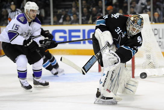 SAN JOSE, CA - APRIL 14: Antti Niemi #31 of the San Jose Sharks clears the puck away from his goal against the Los Angeles Kings in Game One of the Western Conference Quarterfinals during the 2011 NHL Stanley Cup Playoffs at the HP Pavilion on April 14, 2011 in San Jose, California. (Photo by Thearon W. Henderson/Getty Images)