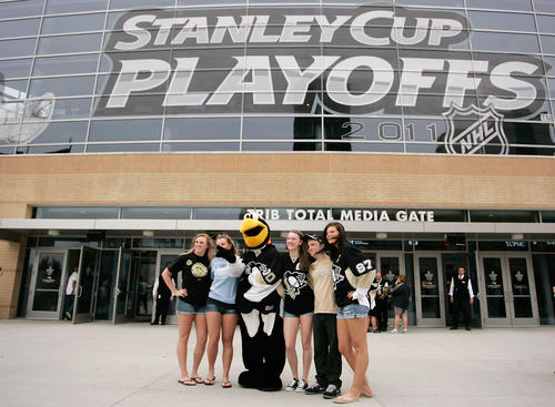 PITTSBURGH, PA - APRIL 15: Iceburg, the Pittsburgh Penguins mascot, poses with fans prior to the start of Game Two of the Eastern Conference Quarterfinals during the 2011 NHL Stanley Cup Playoffs against the Tampa Bay Lightning at Consol Energy Center on April 15, 2011 in Pittsburgh, Pennsylvania. (Photo by Justin K. Aller/Getty Images)