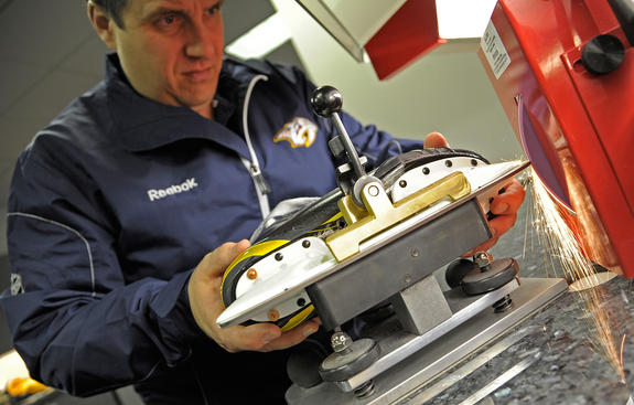 NASHVILLE, TN - APRIL 17: Equipment manager Pete Rogers of the Nashville Predators sharpens a skate before the Predators play against the Anaheim Ducks in Game Three of the Western Conference Quarterfinals during the 2011 NHL Stanley Cup Playoffs at Bridgestone Arena on April 17, 2011 in Nashville, Tennessee. (Photo by John Russell/NHLI via Getty Images)