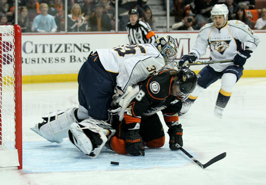 ANAHEIM - APRIL 22: Teemu Selanne #8 of the Anaheim Ducks collides with goalie Pekka Rinne #35 of the Nashville Predators after a Rinne save in Game Five of the Western Conference Quarterfinals during the 2011 NHL Stanley Cup Playoffs at Honda Center on April 22, 2011 in Anaheim, California. (Photo by Stephen Dunn/Getty Images)