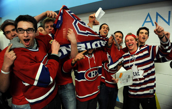 BOSTON, MA - APRIL 23: Fans of the Montreal Canadiens excited to enter the building before the game against the Boston Bruins in Game Five of the Eastern Conference Quarterfinals during the 2011 NHL Stanley Cup Playoffs at TD Garden on April 23, 2010 in Boston, Massachusetts. (Photo by Steve Babineau/NHLI via Getty Images)