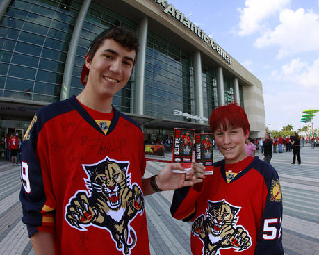 SUNRISE, FL - APRIL 13: (L - R) Matt Tomlinson and Luke Tomlinson hold their playoff tickets for Game One of the Eastern Conference Quarterfinals of the 2012 NHL Stanley Cup Playoffs before entering to see the Florida Panthers play the New Jersey Devils at the BankAtlantic Center on April 13, 2012  in Sunrise, Florida. (Photo by Joel Auerbach/Getty Images)