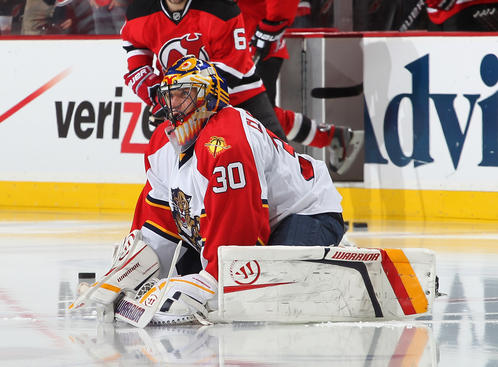 NEWARK, NJ - APRIL 19: Starting goaltender Scott Clemmensen #30 of the Florida Panthers stretches during warmups prior to the game against the New Jersey Devils in Game Four of the Eastern Conference Quarterfinals during the 2012 NHL Stanley Cup Playoffs at the Prudential Center on April 19, 2012 in Newark, New Jersey. (Photo by Andy Marlin/NHLI via Getty Images)