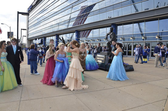 ST. LOUIS, MO - APRIL 21: High school students pose for photos on their way to prom before Game Five of the Western Conference Quarterfinals between the St. Louis Blues and the San Jose Sharks during the 2012 NHL Stanley Cup Playoffs at Scottrade Center on April 21, 2012 in St. Louis, Missouri. (Photo by Mark Buckner/NHLI via Getty Images)