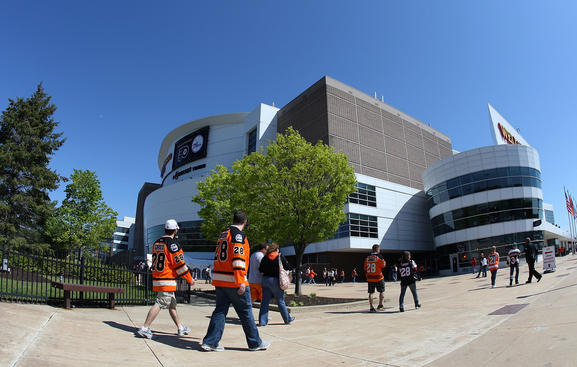 PHILADELPHIA, PA - APRIL 29:  Fans arrive for Game One of the Eastern Conference Semifinals during the 2012 NHL Stanley Cup Playoffs between the New Jersey Devils and Philadelphia Flyers at the Wells Fargo Center on April 29, 2012 in Philadelphia, Pennsylvania.  (Photo by Jim McIsaac/Getty Images)