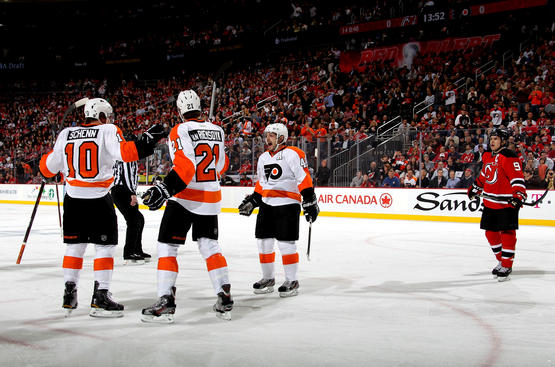 NEWARK, NJ - MAY 03:  Brayden Schenn #10 of the Philadelphia Flyers celebrates with teammates James van Riemsdyk #21 and Danny Briere #48 after scoring a goal against Martin Brodeur #30 of the New Jersey Devils in the first period in Game Three of the Eastern Conference Semifinals during the 2012 NHL Stanley Cup Playoffs at Prudential Center on May 3, 2012 in Newark, New Jersey.  (Photo by Bruce Bennett/Getty Images)