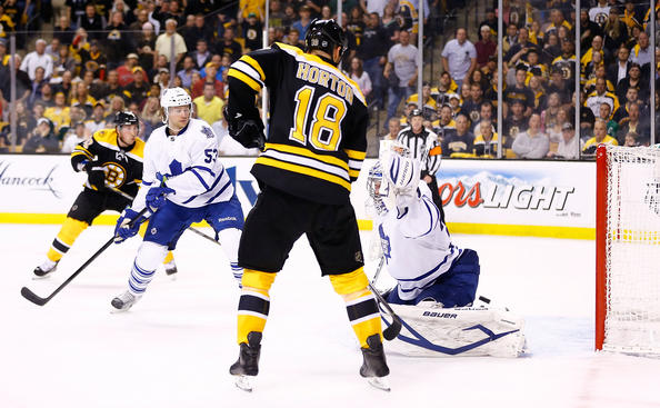 BOSTON, MA - MAY 1: Nathan Horton #18 of the Boston Bruins redirects the puck for a goal in the final seconds of the first period past James Reimer #34 of the Toronto Maple Leafs in Game One of the Eastern Conference Quarterfinals during the 2013 NHL Stanley Cup Playoffs on May 1, 2013 at TD Garden in Boston, Massachusetts. (Photo by Jared Wickerham/Getty Images)