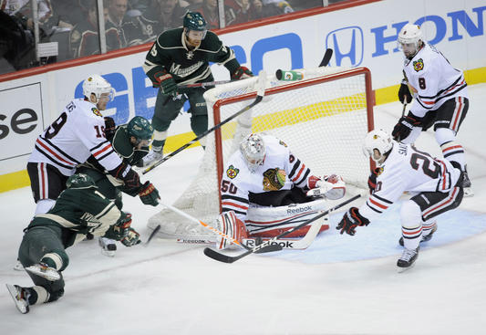 ST PAUL, MN - MAY 5: Corey Crawford #50 of the Chicago Blackhawks deflects a shot by Torrey Mitchell #17 of the Minnesota Wild during the first period of Game Three of the Western Conference Quarterfinals during the 2013 NHL Stanley Cup Playoffs at Xcel Energy Center on May 5, 2013 in St Paul, Minnesota. (Photo by Hannah Foslien/Getty Images)