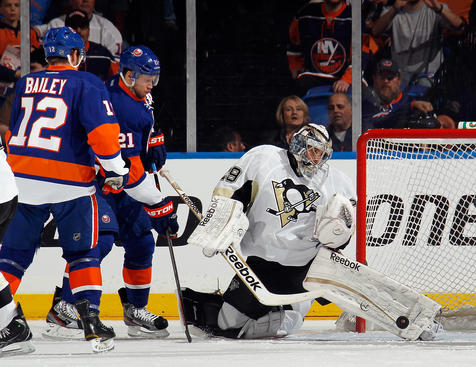 UNIONDALE, NY - MAY 07: Marc-Andre Fleury #29 of the Pittsburgh Penguins makes the first period save as Josh Bailey #12 and Kyle Okposo #21 of the New York Islanders look for a rebound in Game Four of the Eastern Conference Quarterfinals during the 2013 NHL Stanley Cup Playoffs at the Nassau Veterans Memorial Coliseum on May 7, 2013 in Uniondale, New York.  (Photo by Bruce Bennett/Getty Images)