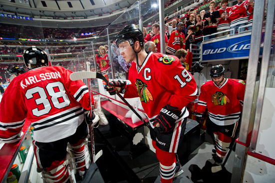 CHICAGO, IL - MAY 9: Jonathan Toews #19 of the Chicago Blackhawks walks out to the ice, as teammate Brent Seabrook #7 follows behind, before Game Five of the Western Conference Quarterfinals against the Minnesota Wild during the 2013 Stanley Cup Playoffs at the United Center on May 09, 2013 in Chicago, Illinois. (Photo by Bill Smith/NHLI via Getty Images)