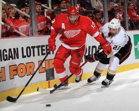 DETROIT, MI - MAY 10:  Pavel Datsyuk #13 of the Detroit Red Wings and Francois Beauchemin #23 of the Anaheim Ducks battle for the puck behind the net during Game Six of the Western Conference Quarterfinals during the 2013 NHL Stanley Cup Playoffs at Joe Louis Arena on May 10, 2013 in Detroit, Michigan.  (Photo by Dave Reginek/NHLI via Getty Images)