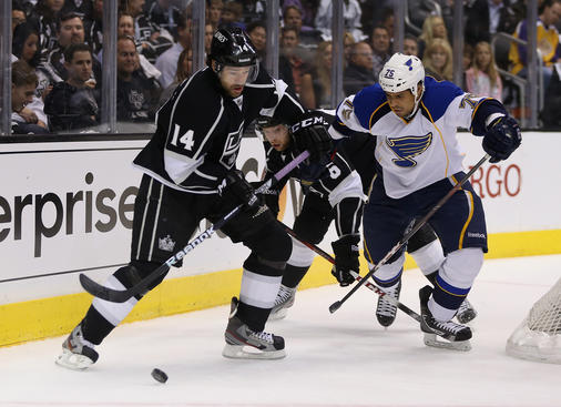 LOS ANGELES, CA - MAY 10:  Justin Williams #14 of the Los Angeles Kings is pursued by Ryan Reaves #75 of the St. Louis Blues for the puck in the first period of Game Six of the Western Conference Quarterfinals during the 2013 NHL Stanley Cup Playoffs at Staples Center on May 10, 2013 in Los Angeles, California.  (Photo by Jeff Gross/Getty Images)