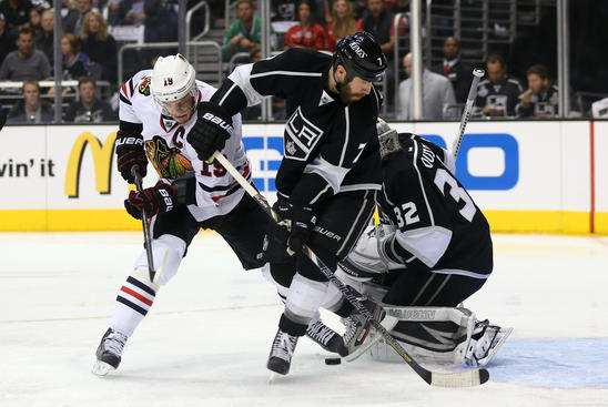 LOS ANGELES, CA - JUNE 06:  Jonathan Toews #19 of the Chicago Blackhawks and Rob Scuderi #7 of the Los Angeles Kings look for the rebound near the crease area in the first period of Game Four of the Western Conference Final during the 2013 NHL Stanley Cup Playoffs at Staples Center on June 6, 2013 in Los Angeles, California. Toews did not score.  (Photo by Jeff Gross/Getty Images)