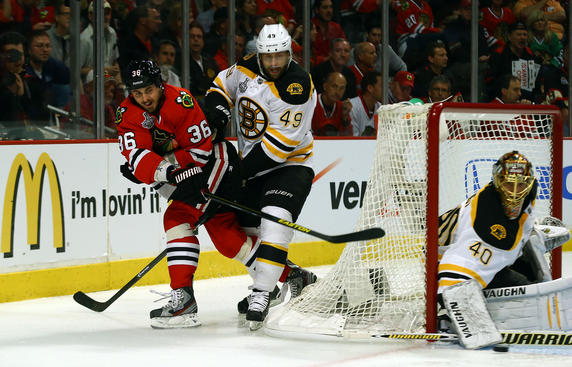 CHICAGO, IL - JUNE 12:  Dave Bolland #36 of the Chicago Blackhawks passes the puck against Rich Peverley #49 of the Boston Bruins in Game One of the NHL 2013 Stanley Cup Final at United Center on June 12, 2013 in Chicago, Illinois.  (Photo by Bruce Bennett/Getty Images)