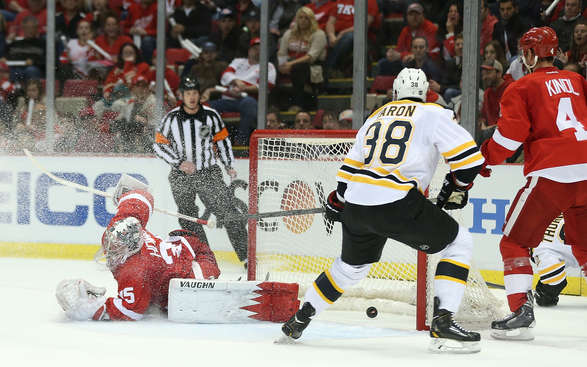 DETROIT, MI - APRIL 22: Jordan Caron #38 of the Boston Bruins scores a first-period goal on golie Jimmy Howard #35 of the Detroit Red Wings against the Detroit Red Wings in Game One of the First Round of the 2014 NHL Stanley Cup Playoffs at Joe Louis Arena on April 22, 2014 in Detroit, Michigan.  (Photo by Leon Halip/Getty Images)