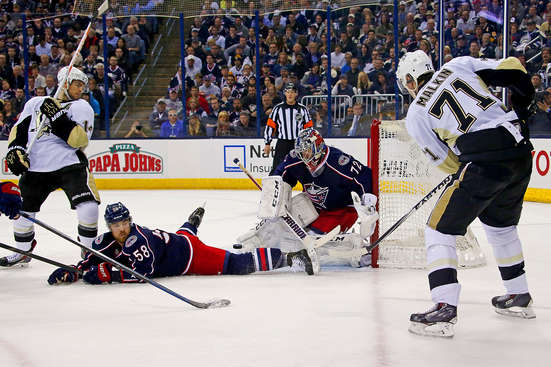 COLUMBUS, OH - APRIL 23:  David Savard #58 of the Columbus Blue Jackets slides in an attempt to block the puck as Evgeni Malkin #71 of the Pittsburgh Penguins shoots the puck past Sergei Bobrovsky #72 of the Columbus Blue Jackets during the first period in Game Four of the First Round of the 2014 NHL Stanley Cup Playoffs at Nationwide Arena on April 23, 2014 in Columbus, Ohio. (Photo by Kirk Irwin/Getty Images)