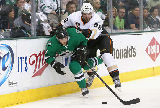 DALLAS, TX - APRIL 23:  Tyler Seguin #91 of the Dallas Stars skates the puck against Mark Fistric #28 of the Anaheim Ducks in the first period during Game Four of the First Round of the 2014 NHL Stanley Cup Playoffs at American Airlines Center on April 23, 2014 in Dallas, Texas.