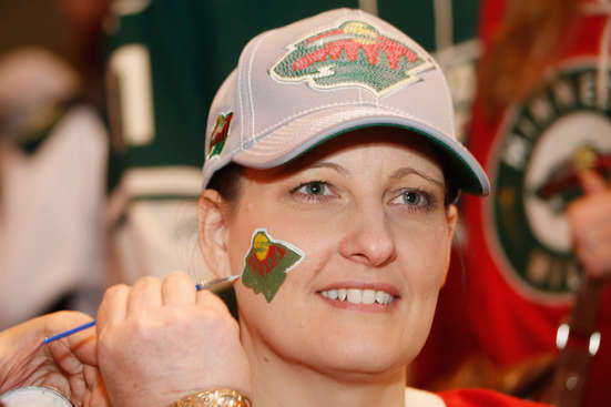 ST. PAUL, MN - APRIL 24: A Minnesota Wild fan has her face painted prior to Game Four of the First Round of the 2014 Stanley Cup Playoffs against the Colorado Avalanche on April 24, 2014 at the Xcel Energy Center in St. Paul, Minnesota. (Photo by Bruce Kluckhohn/NHLI via Getty Images)