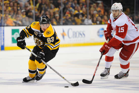BOSTON, MA - APRIL 26: Brad Marchand #63 of the Boston Bruins skates with the puck against Riley Sheahan #15 of the Detroit Red Wings in Game Five of the First Round of the 2014 Stanley Cup Playoffs at TD Garden on April 26, 2014 in Boston, Massachusetts. (Photo by Brian Babineau/NHLI via Getty Images)