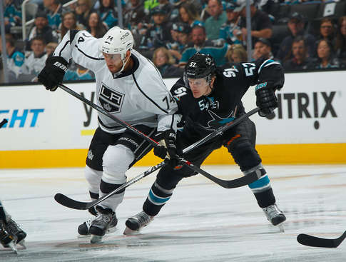 SAN JOSE, CA - APRIL 26: Tommy Wingels #57 of the San Jose Sharks battles for the puck against Dwight King #74 of the Los Angeles Kings in Game Five of the First Round of the 2014 Stanley Cup Playoffs at SAP Center on April 26, 2014 in San Jose, California. (Photo by Don Smith/NHLI via Getty Images)