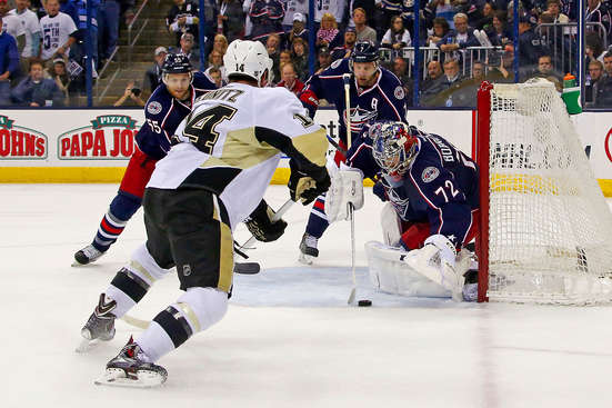 COLUMBUS, OH - APRIL 28:  Sergei Bobrovsky #72 of the Columbus Blue Jackets covers up a wrap-around attempt by Chris Kunitz #14 of the Pittsburgh Penguins during the first period of Game Six of the First Round of the 2014 NHL Stanley Cup Playoffs at Nationwide Arena on April 28, 2014 in Columbus, Ohio. (Photo by Kirk Irwin/Getty Images)