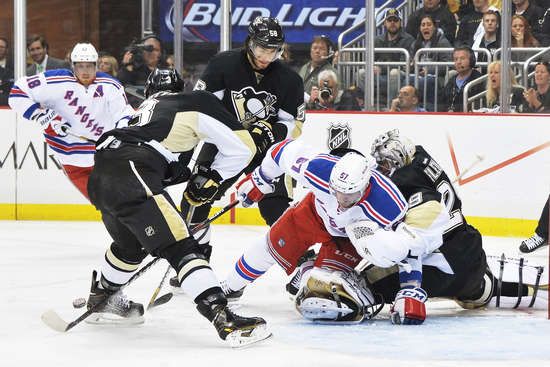 PITTSBURGH, PA - MAY 4:  Benoit Pouliot #67 of the New York Rangers falls over goaltender Marc-Andre Fleury #29 of the Pittsburgh Penguins as Olli Maatta #3 of the Penguins clears the puck from the front of the crease in the first period in Game Two of the Second Round of the 2014 NHL Stanley Cup Playoffs on May 4, 2014 at Consol Energy Center in Pittsburgh, Pennsylvania.  (Photo by Jamie Sabau/Getty Images)