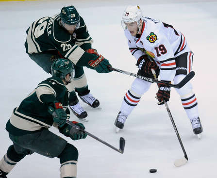 ST PAUL, MN - MAY 6: Jonathan Toews #19 of the Chicago Blackhawks controls the puck against Zach Parise #11 and Jason Pominville #29 of the Minnesota Wild during the first period in Game Three of the Second Round of the 2014 NHL Stanley Cup Playoffs on May 6, 2014 at Xcel Energy Center in St Paul, Minnesota. (Photo by Hannah Foslien/Getty Images)