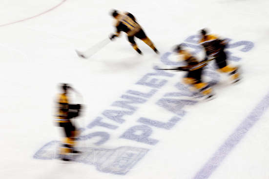 BOSTON, MA - MAY 14:  The Boston Bruins skate before Game Seven of the Second Round of the 2014 NHL Stanley Cup Playoffs against the Montreal Canadiens at the TD Garden on May 14, 2014 in Boston, Massachusetts.  (Photo by Alex Trautwig/Getty Images)