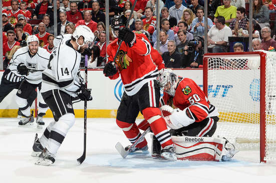 CHICAGO, IL - MAY 21: Justin Williams #14 of the Los Angeles Kings is able to score on goalie Corey Crawford #50 of the Chicago Blackhawks, as teammate Dwight King #74 watches in the background, in Game Two of the Western Conference Final during the 2014 NHL Stanley Cup Playoffs at the United Center on May 21, 2014 in Chicago, Illinois. (Photo by Bill Smith/NHLI via Getty Images)