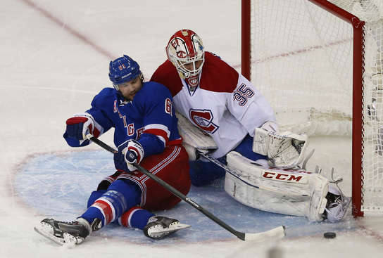NEW YORK, NY - MAY 22: Dustin Tokarski #35 of the Montreal Canadiens denies Rick Nash #61 of the New York Rangers in Game Three of the Eastern Conference Final during the 2014 NHL Stanley Cup Playoffs at Madison Square Garden on May 22, 2014 in New York City.  (Photo by Elsa/Getty Images)