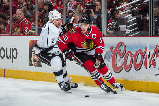 CHICAGO, IL - MAY 28: Jonathan Toews #19 of the Chicago Blackhawks and Matt Greene #2 of the Los Angeles Kings chase the puck in Game Five of the Western Conference Final during the 2014 NHL Stanley Cup Playoffs at the United Center on May 28, 2014 in Chicago, Illinois. (Photo by Bill Smith/NHLI via Getty Images)