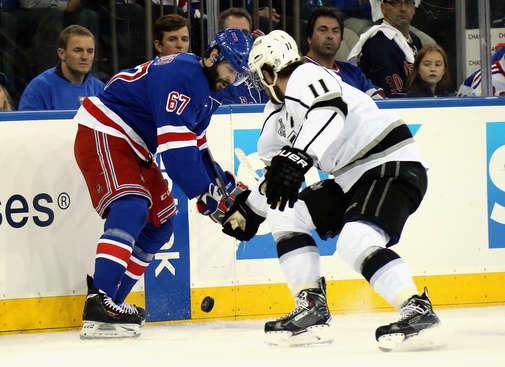 NEW YORK, NY - JUNE 09:  Anze Kopitar #11 of the Los Angeles Kings battles Benoit Pouliot #67 of the New York Rangers for the puck during Game Three of the 2014 NHL Stanley Cup Final at Madison Square Garden on June 9, 2014 in New York, New York.  (Photo by Bruce Bennett/Getty Images)