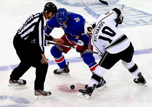 NEW YORK, NY - JUNE 11:  Derick Brassard #16 of the New York Rangers and Mike Richards #10 of the Los Angeles Kings face-off during the first period of Game Four of the 2014 NHL Stanley Cup Final at Madison Square Garden on June 11, 2014 in New York, New York.  (Photo by Jim McIsaac/Getty Images)