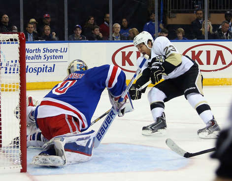 NEW YORK, NY - APRIL 16: Henrik Lundqvist #30 on Steve Downie #23 of the Pittsburgh Penguins in Game One of the Eastern Conference Quarterfinals during the 2015 Stanley Cup Playoffs at Madison Square Garden on April 16, 2015 in New York City.  (Photo by Bruce Bennett/Getty Images)