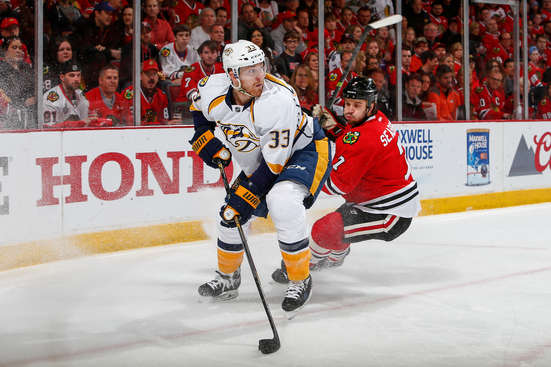 CHICAGO, IL - APRIL 25:  Colin Wilson #33 of the Nashville Predators grabs the puck as Brent Seabrook #7 of the Chicago Blackhawks chases in Game Six of the Western Conference Quarterfinals during the 2015 NHL Stanley Cup Playoffs at the United Center on April 25, 2015 in Chicago, Illinois.  (Photo by Bill Smith/NHLI via Getty Images)
