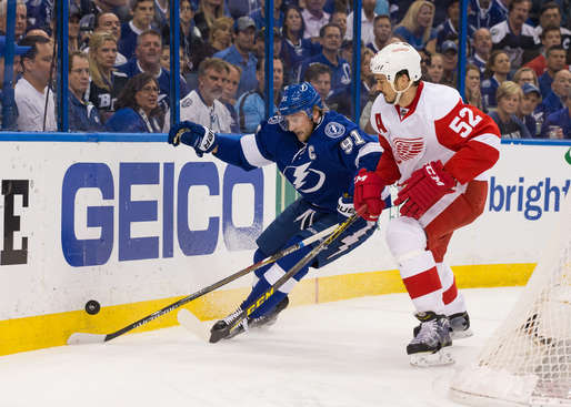 TAMPA, FL - APRIL 29: Steven Stamkos #91 of the Tampa Bay Lightning battles for the puck along the boards against Jonathan Ericsson #52 of the Detroit Red Wings during the first period of Game Seven of the Eastern Conference Quarterfinals during the 2015 NHL Stanley Cup Playoffs at the Amalie Arena on April 29, 2015 in Tampa, Florida.  (Photo by Scott Audette/NHLI via Getty Images)