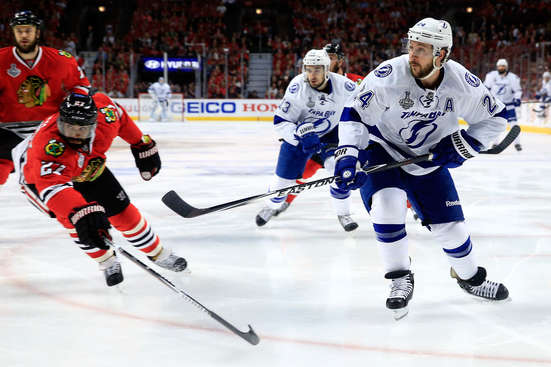 CHICAGO, IL - JUNE 10: Ryan Callahan #24 of the Tampa Bay Lightning takes a shot in the first period as Johnny Oduya #27 of the Chicago Blackhawks defends during Game Four of the 2015 NHL Stanley Cup Final at the United Center on June 10, 2015 in Chicago, Illinois.  (Photo by Tasos Katopodis/Getty Images)