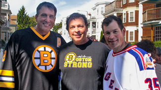Cam Neely and Mike Richter pose with film director Bobby Farrelly on the set of the 2013 Discover NHL Thanksgiving Showdown NBC commercial shoot.