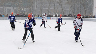 Former NHL players took to the snowy ice to play an hour of shinny in New York's Bryant Park.